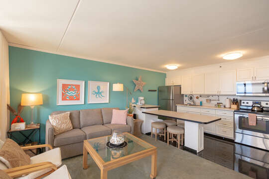 Overview of  kitchen area and living area with  plenty of  seating options