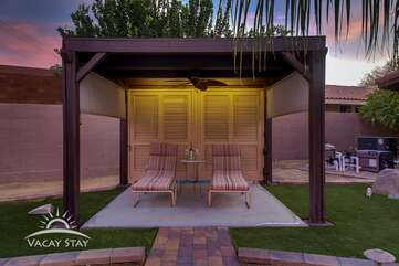 Custom cabana complete with lights, ceiling fan and shades all around for privacy