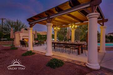 Oversized support columns hold up the outdoor dining roof