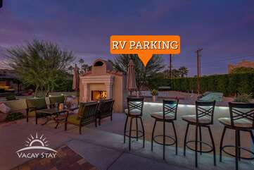 Mix up a martini at the outdoor bar.The back gates open to allow RV parking on the concrete pad. Easy access from the rear of home