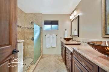Bathroom 1 (master bath) has modern his & hers sinks