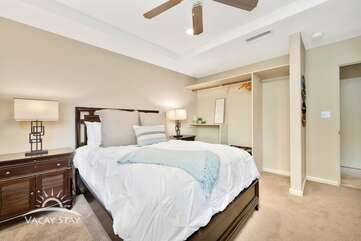 Bedroom 2 is located across from the master bedroom