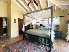Upper level guest bedroom features another luxurious King size bed and en suite bathroom
