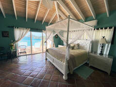 Master Bedroom features luxurious king bed and and en suite full bathroom