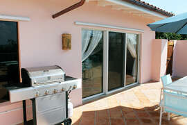 BBQ Grill is located on pool deck between great room and bedroom 2