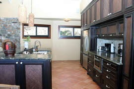 Well appointed gourmet kitchen with beautiful unique stone counters