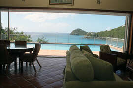 View looking outside from great room over pool.  Amazing Cool Breezes with the glass doors fully opened!