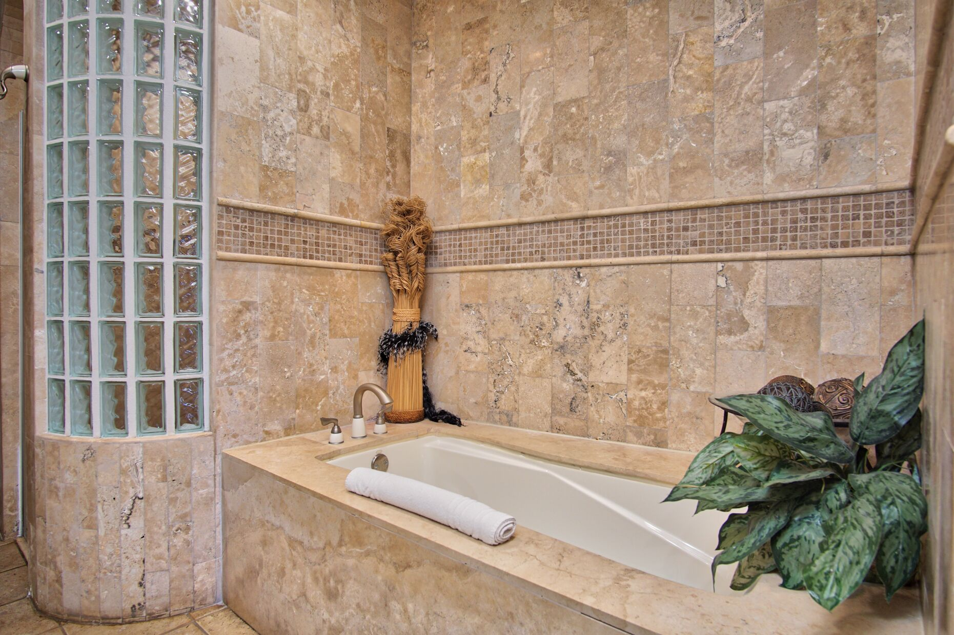 Tub and glass block in master bedroom