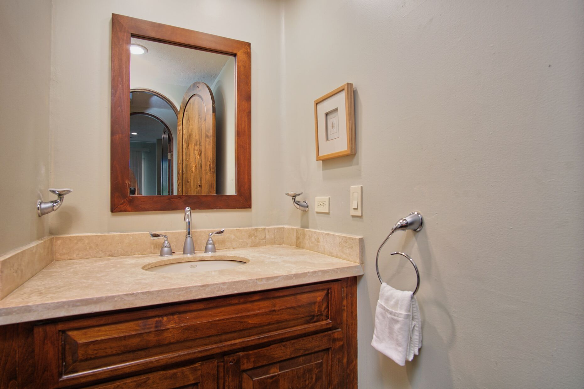 Guest bathroom with shower and vanity sink