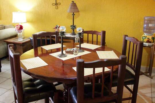 Dinning table has been redone and barstools added to the dining area.