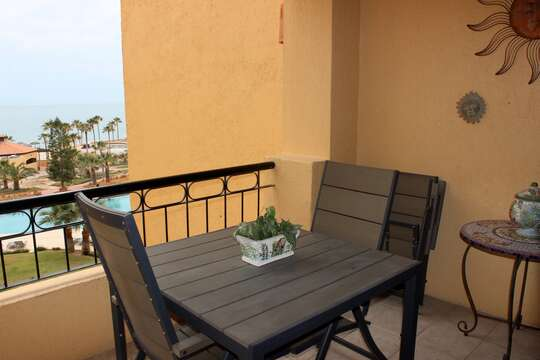 Balcony has been updated with new patio furniture.
