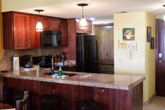 Kitchen has been totally remodeled.  It has new cabinets, appliances, and lighting.