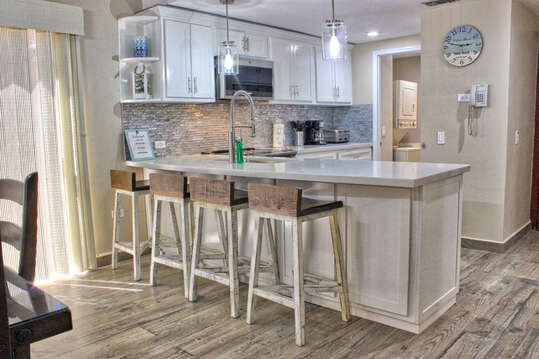Kitchen with bar stools.