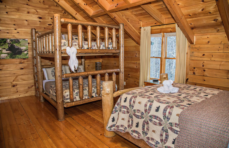 Bedroom with Bunk Bed and Large Bed.