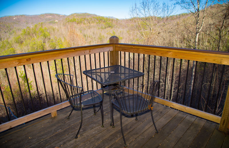 Outdoor Table and Chairs in the Upper-Level Deck.