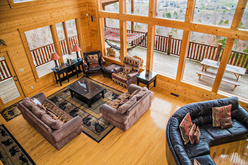 Aerial view of living room area and wide windows