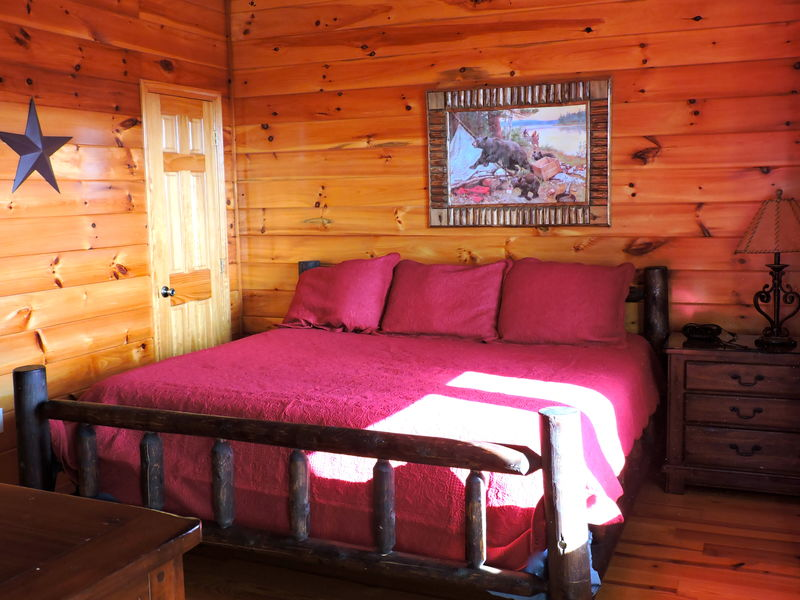 4th bedroom located on middle floor has king size bed, flatscreen TV, and private bathroom.