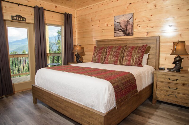 Bedroom with Pine Walls, Gray Curtains, and Red Linens