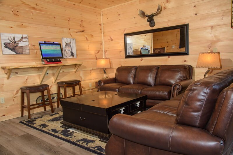 Lounge Room with Comfy Leather Couches and Pine Walls
