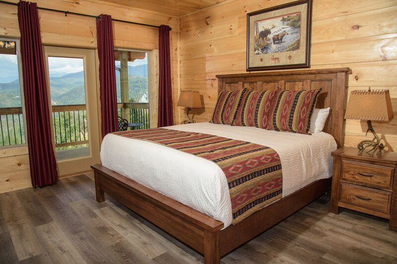 Bedroom with Red Curtains and Views of Gatlinburg Wilderness