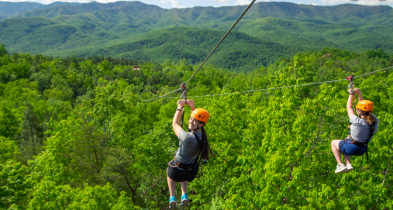 Two People Zip Lining in the Gatlinburg Wilderness