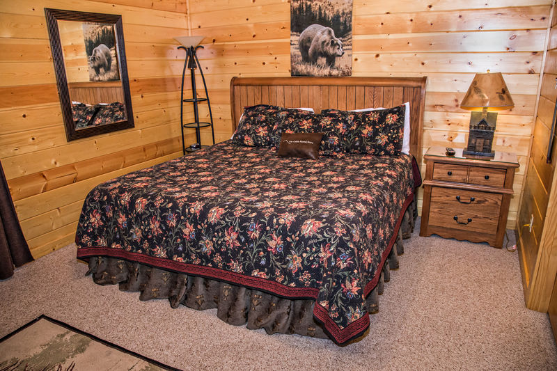 Bedroom with King Bed, TV, & Full Bath with Bath/Shower Combination & Sin, located on lower level