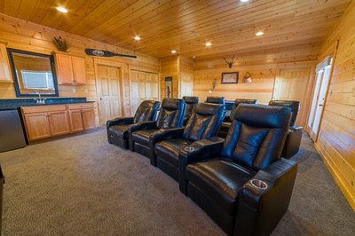 8 person Recliner Seating, & Wet Bar in Theater Room, located in each cabin.