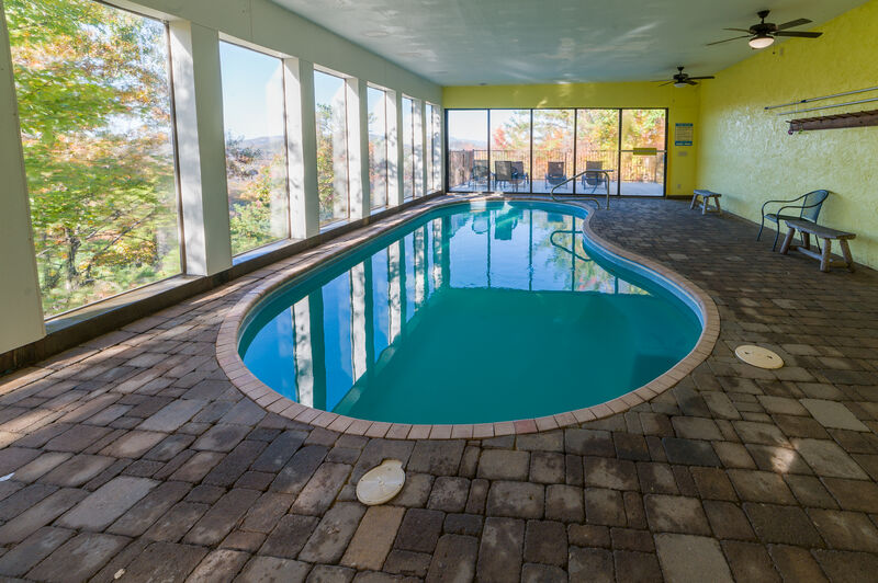 Indoor/Outdoor Heated Pool with Panoramic Mountain Views, & Wall of Sliding Glass Doors to let in the Fresh Mountain Air!