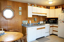 The kitchen includes a full size refrigerator,dishwasher,  microwave and stove.     The kitchen is equipped with pots/pans/dishes and anything you need to make your stay comfortable and relaxing.
