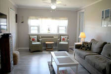 It has a newly remodeled living room with updated air conditioner/heater, a queen sleeper sofa and tables and a laminate floor and a 43 inch LCD  t.v. With cable and WiFi.