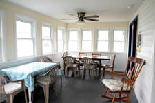 New windows in this enclosed porch and plenty of seating