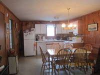 Kitchen and Dining Area is fully equipped with dishwasher, microwave, 4 burner stove and oven. Ice maker in fridge, blender, lobster pot, toaster oven and coffee maker.