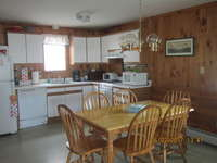 Kitchen includes all the dishes, glassware and pots and pans that you will need to enjoy your stay. Dinning table has seating for six and can accommodate eight.