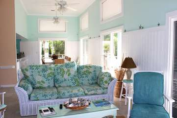 Soft green and blue hues and wainscot paneling create a peaceful atmosphere.