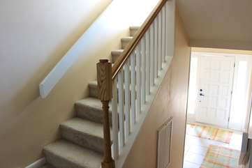 Follow the stairs to the main living area.