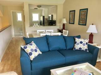 The living area is on the 2nd floor & has high ceilings and hardwood floors. A queen sleeper sofa is in the living room.