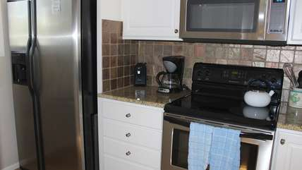 Granite countertops, tile and stainless appliances are highlights.