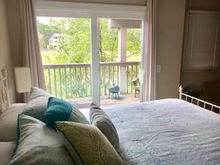 The master bedroom has a queen bed and fantastic views through the sliding doors.