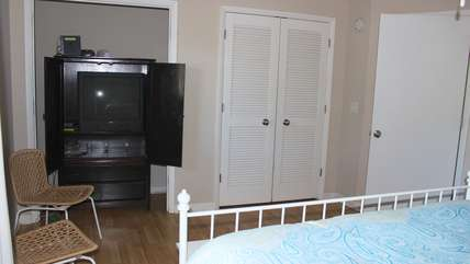 The armoire has a large flat screen TV.