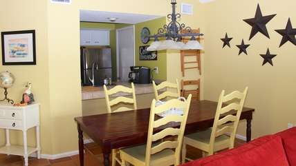 The dining area has a farm table that can seat 6.
