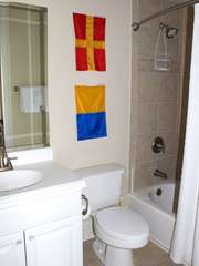 The bath is also accessible from the hall and has a shower/tub.