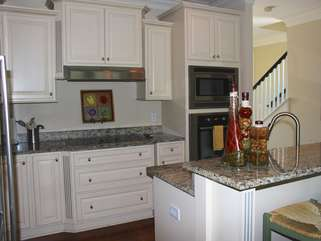 Other features include custom cabinetry and granite counters.