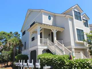This great home is located just outside the Seabrook Island gate.