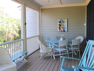 Step to the porch and enjoy appetizers around the table for six.