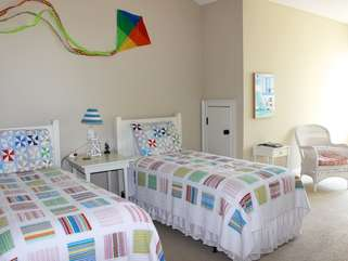 The 3rd bedroom has two twin beds.