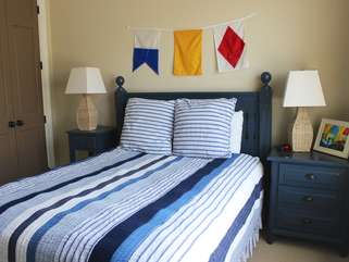 The bedroom has a queen bed and adjoining bathroom.