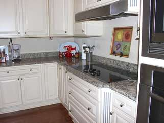 Stainless appliances and a flat cook top made cooking easy.