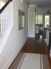 Head down the hall to living and kitchen area