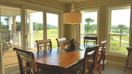 Dining Room table & chairs; sliding door access to patio with sweeping golf course vistas (and two spare kitchen counter stools)