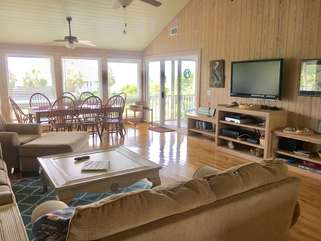 Here is a large HDTV viewable from anywhere in the living room/dining room.